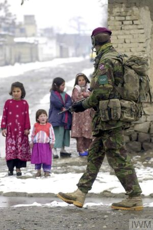 The Wick - BRITISH FORCES IN AFGHANISTAN, OPERATION FINGAL 2002 (LAND-02-012-0865) A paratrooper of Bruneval Company, 2nd Battalion The Parachute Regiment, passes a group of young children during a security patrol in the centre of Kabul Afghanistan, February 2002.  British troops were deployed in Afghanistan on Operation FINGAL under the auspices of the International Security Assistance Force (ISAF). The mission was to assist the interim administration with security and stabilit... Copyright: © IWM. Original Source: http://www.iwm.org.uk/collections/item/object/205217188