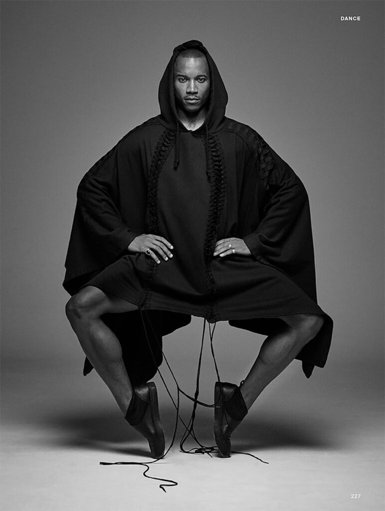 Eric Underwood poses in a long black robe