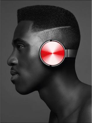 Model posing with headphones. Hair cut by Barber Emmett Williams.