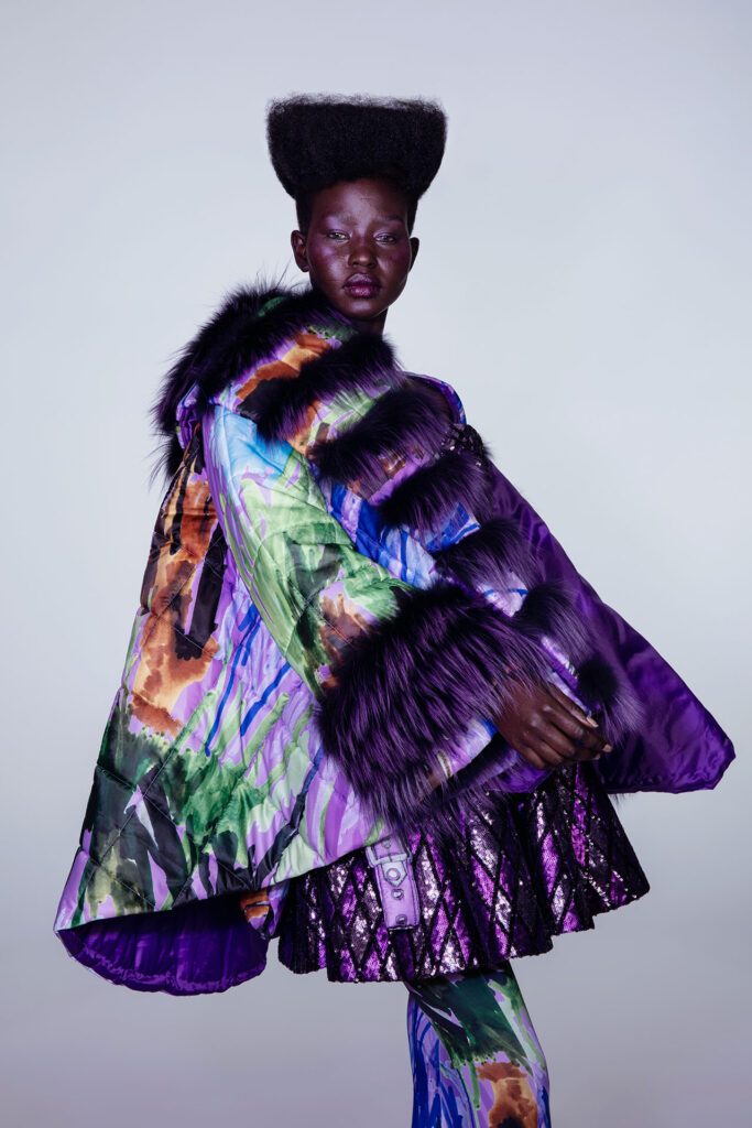 Aweng Chuol poses in a colourful dress for Paper Magazine
