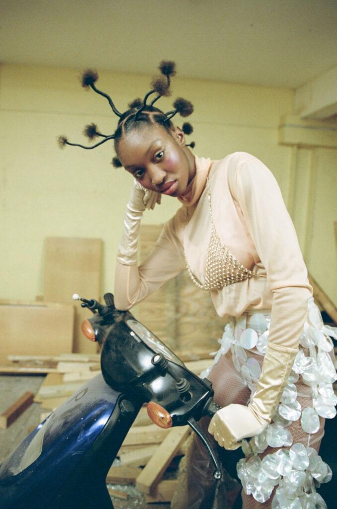 Female model posing on motor bike