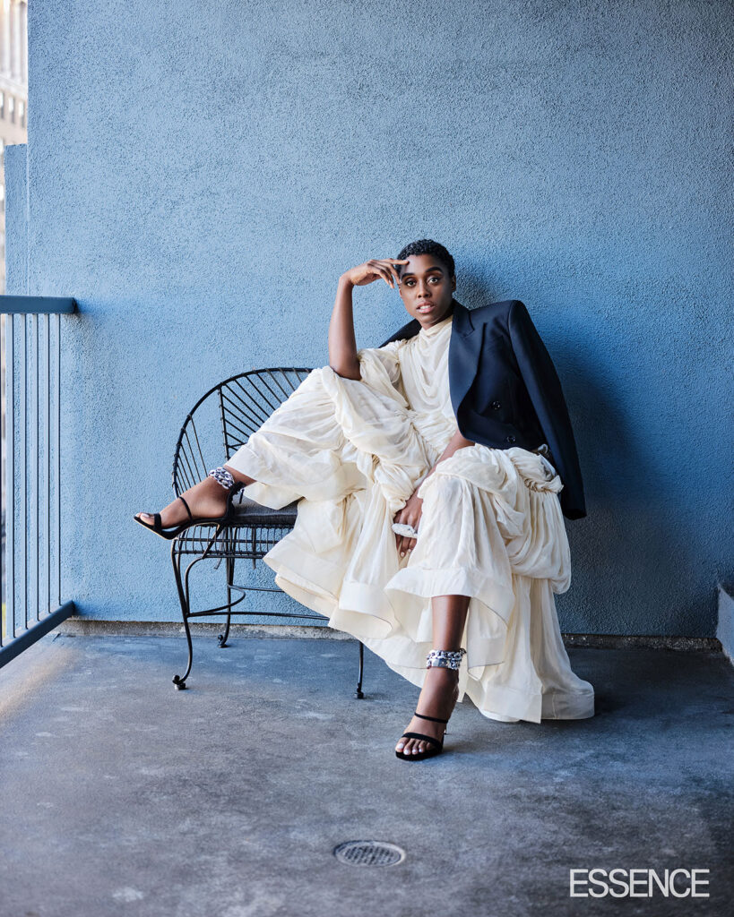 Lashana Lynch models white dress