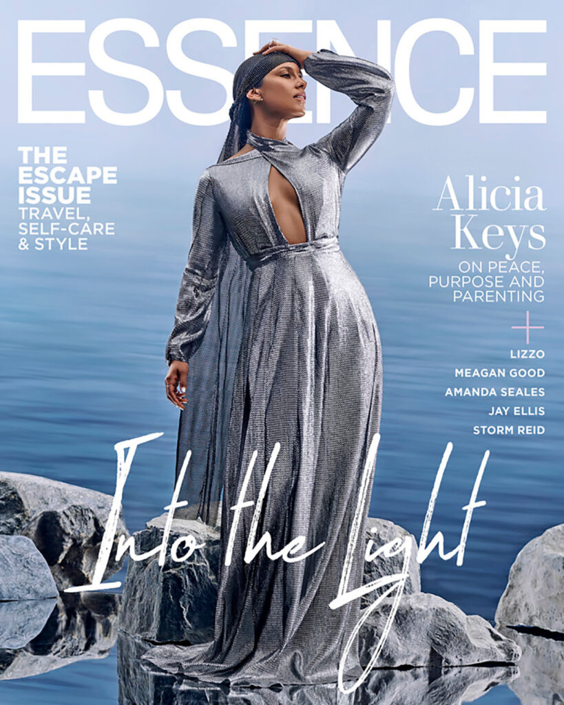 Alicia Keys models a silver dress for essence magazine cover