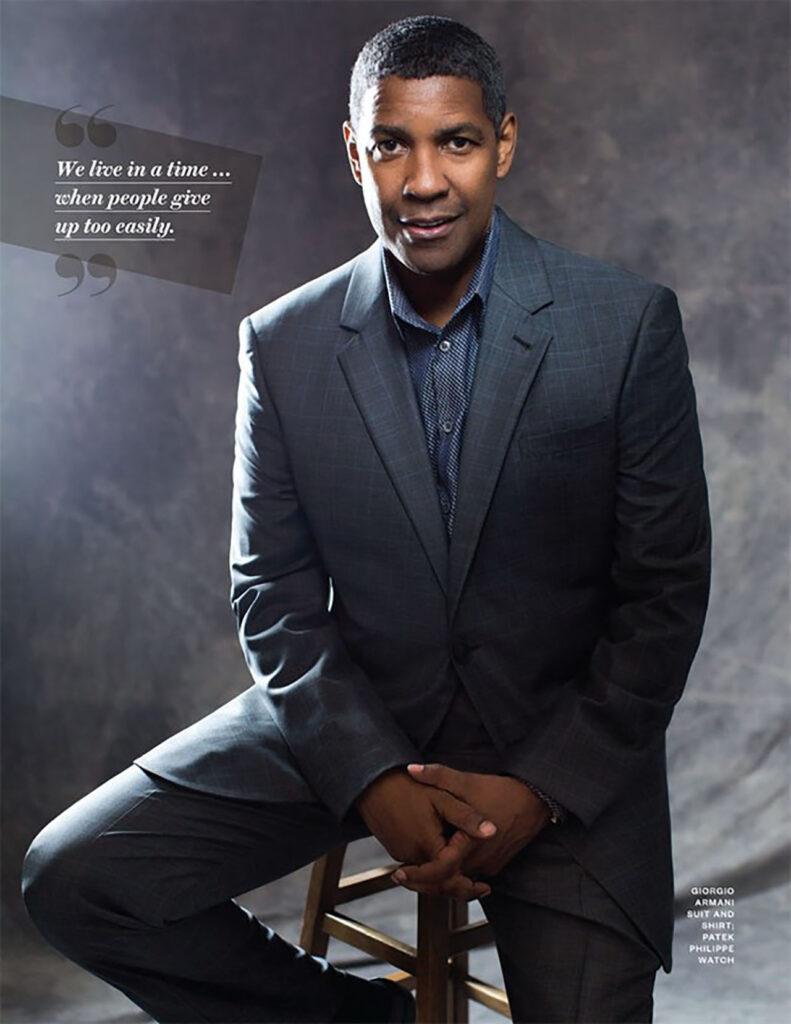 Denzel washington poses wearing a grey suit
