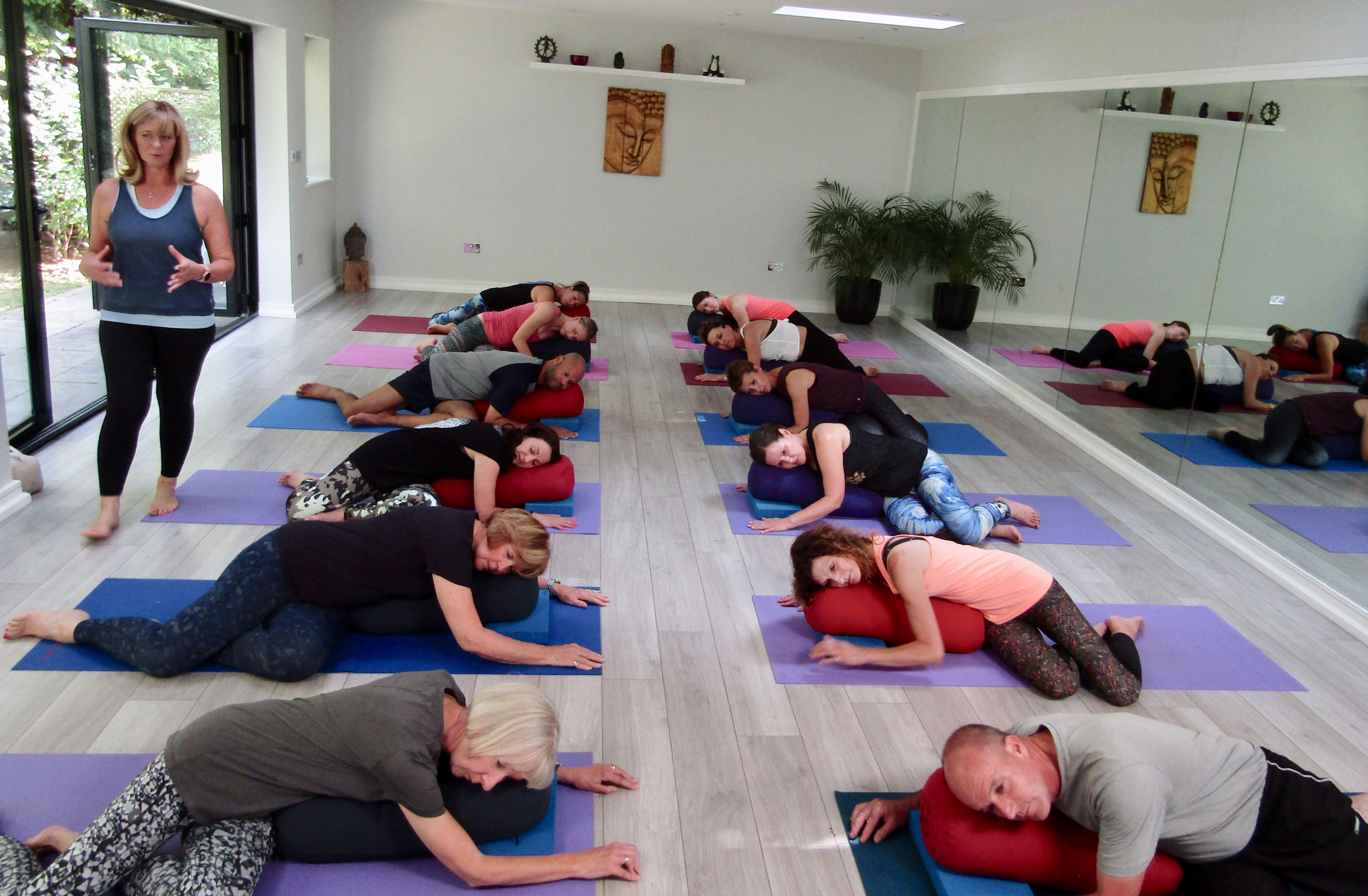 A restorative yoga class in the studio