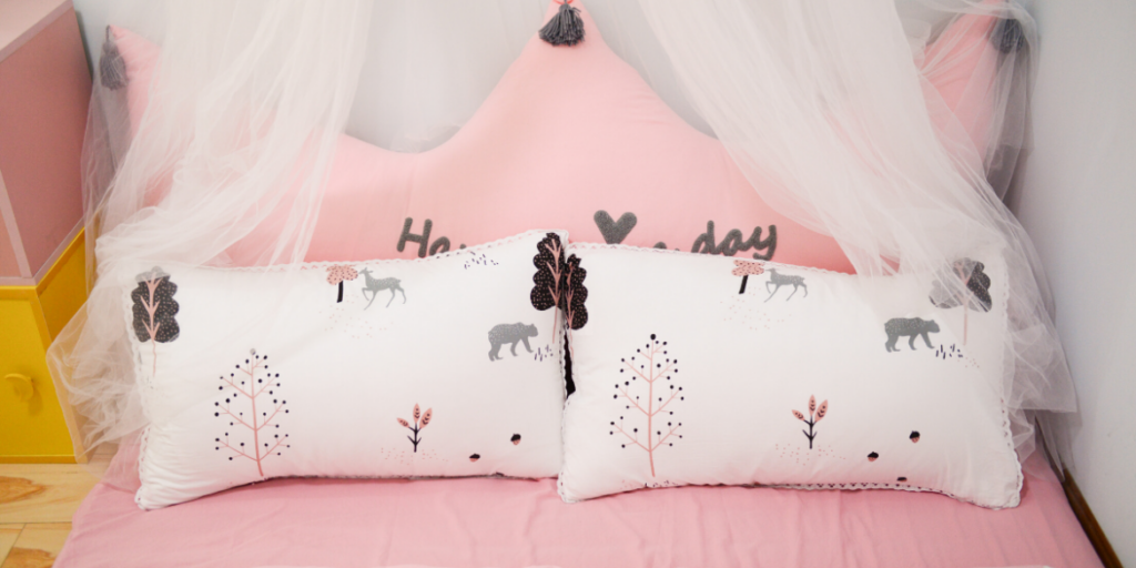 bedmaking , childs pink bed