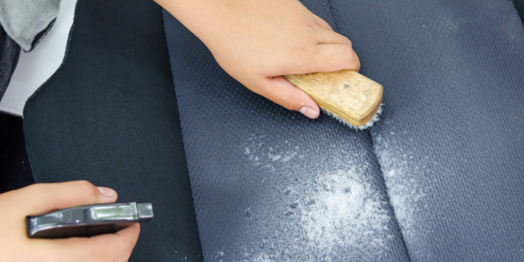 removing stains from  car seat with  brush and spray