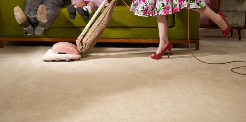 50's housewife vacuuming
