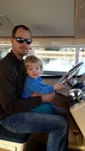 Daddy and son enjoying our Herbert Woods boat last year