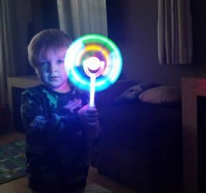 Playing with a light stick he borrowed from our friends