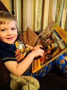 L Loves his new book and 'jamas