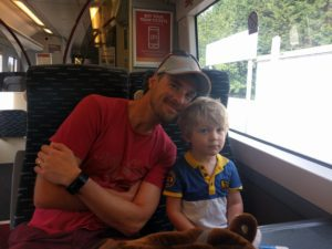 Father and son on a train