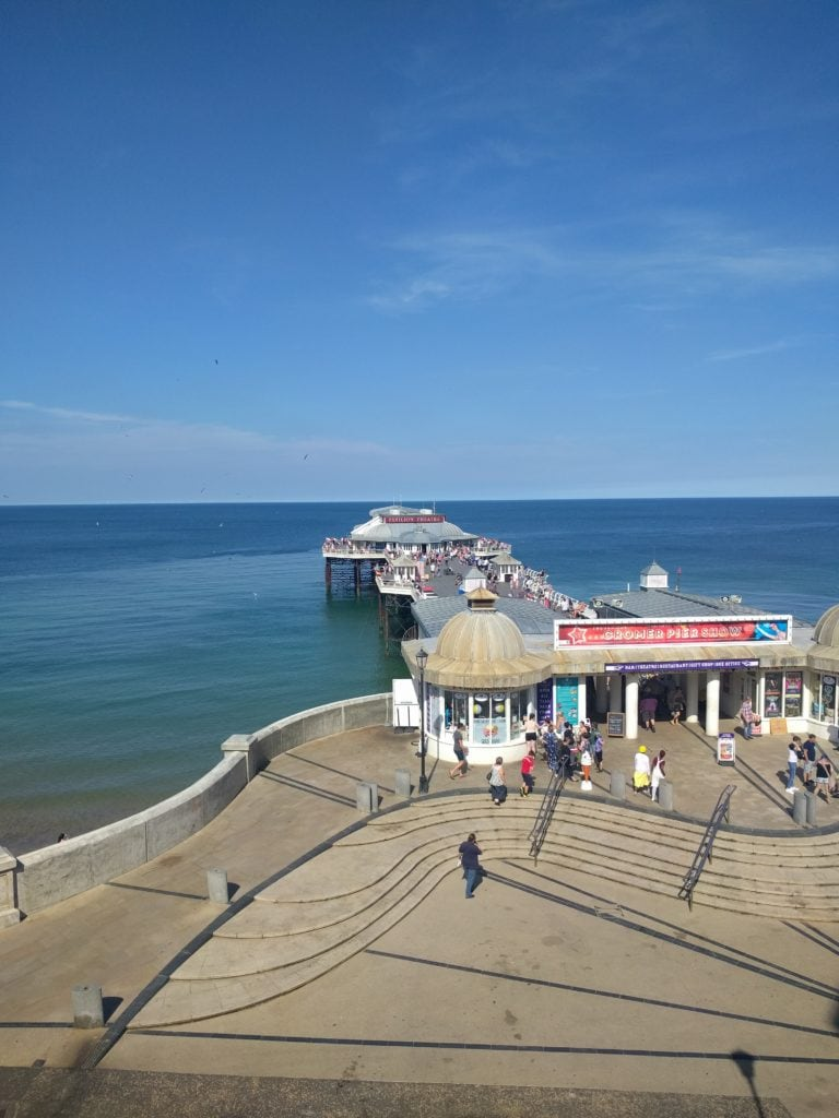 A view of Cromer Pier and bright blue sea