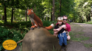 Son and dad posing next to Fox