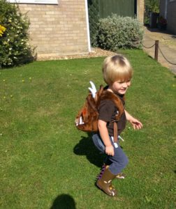 Boy in Gruffalo Spotting rucksack and wellie combo