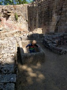 Prudhoe Castle small boy inside a stone basin