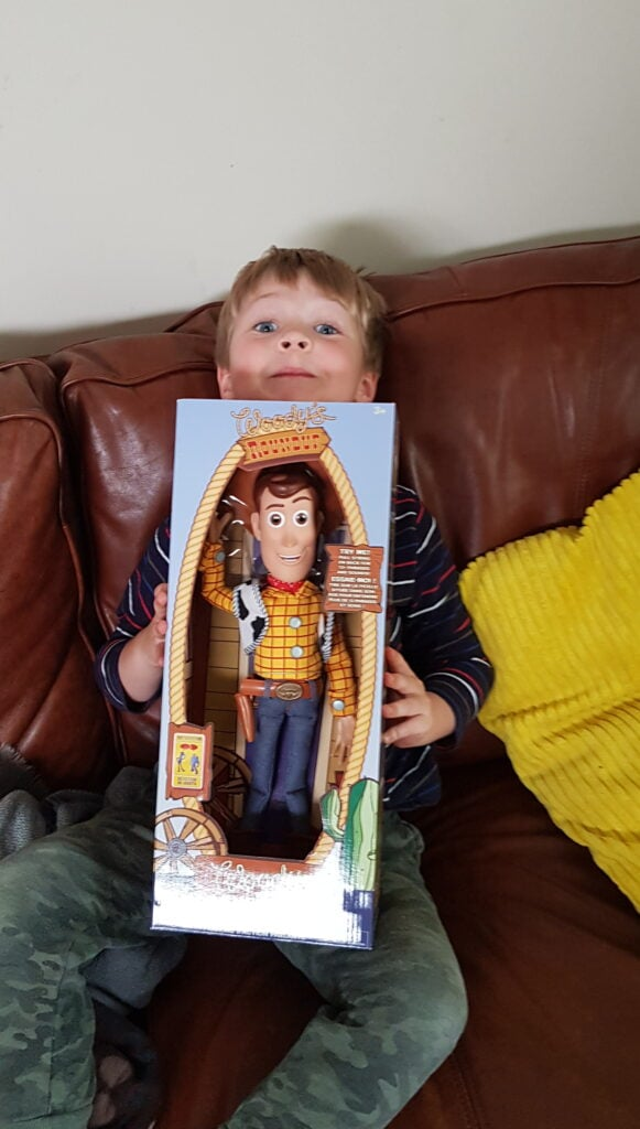 Boy woth boxed Woody Toy