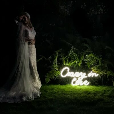 crazy in love neon sign with wedding couple
