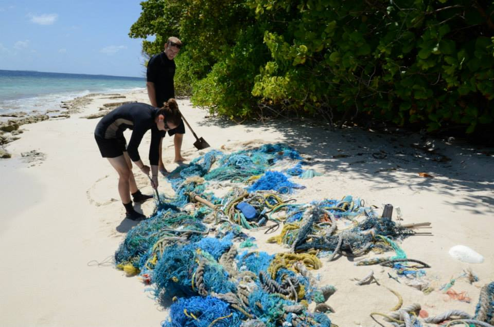 ORP staff sampling ghost nets on the beach