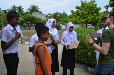 Dr Jillian Hudgings talking with Maldivian school children