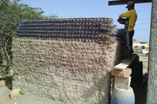 Hut made from plastic bottles and ghost net under contruction
