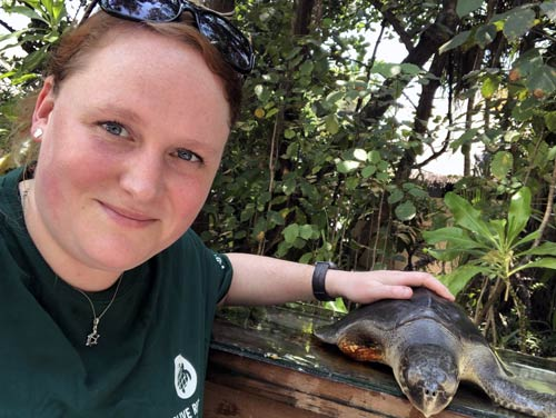 Visiting Vet Sonya Miles with one of the turtle patients she helped care for at the ORP Marine Turtle Rescue Centre.