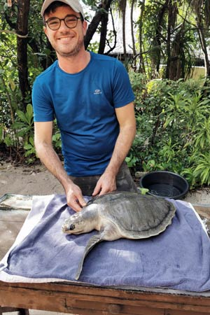 Visiting Vet Franceso and turtle patient Arti