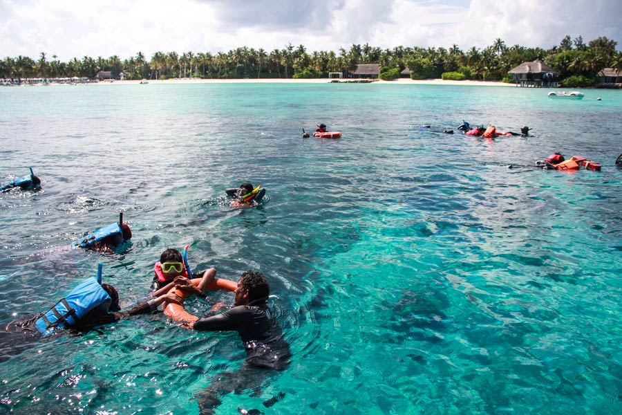 Marine Education Programme, Immaduddin School students snorkeling with wild turtles at One & Only Reethi Rah Maldives