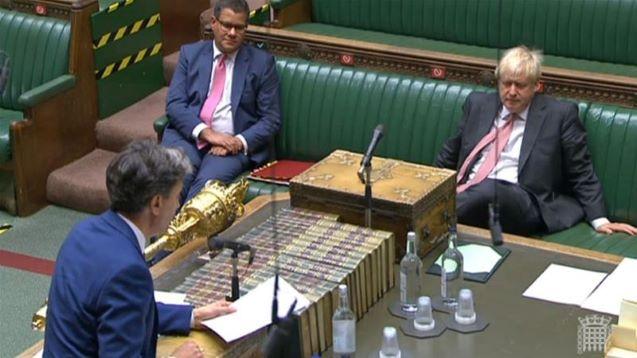 British MPs back Brexit bill despite anger over treaty breach