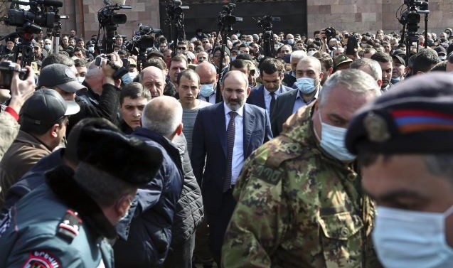 Armenian PM faces military's demand to resign, talks of coup