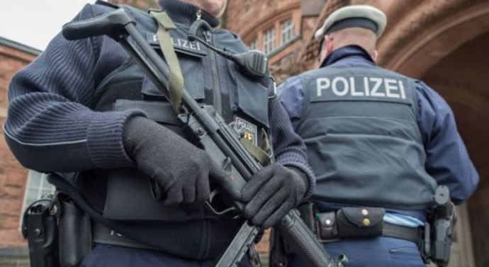 Major police raids carried out around German capital after Islamist group, which called for death of Jews, outlawed by authorities