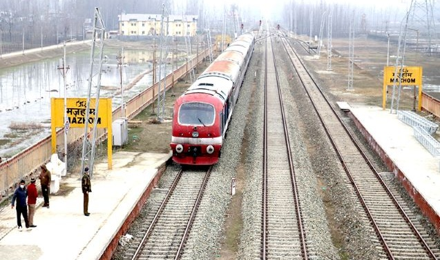 Kashmir: As train chugs after 11 months, travellers cheer up