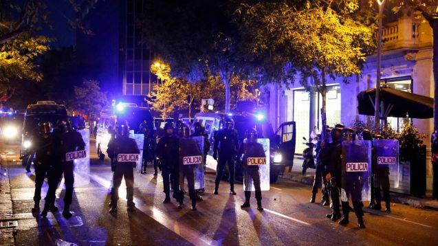 Catalan police arrest 8 in protests for jailed rapper