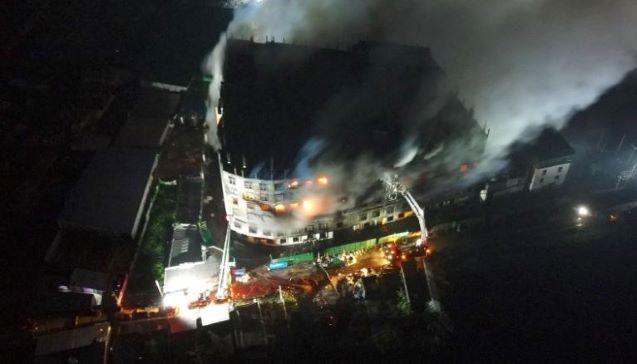 Bangladesh factory fire: Owner arrested after blaze kills 52