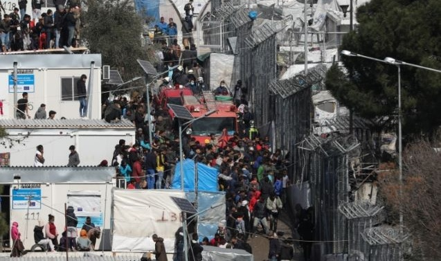 New Greek camp pushes refugees out of sight