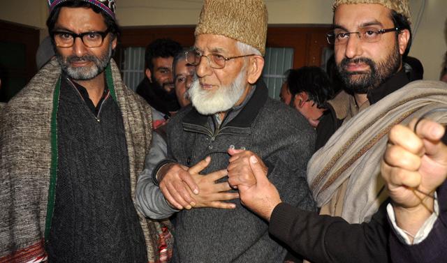 India locks down Kashmir after quiet burial of separatist Geelani
