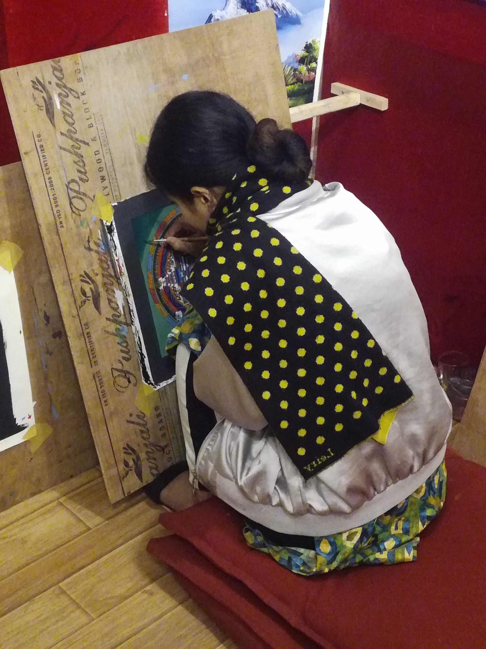 Vedere qualcuno disegnare un Mandala