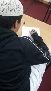 Students writing in class