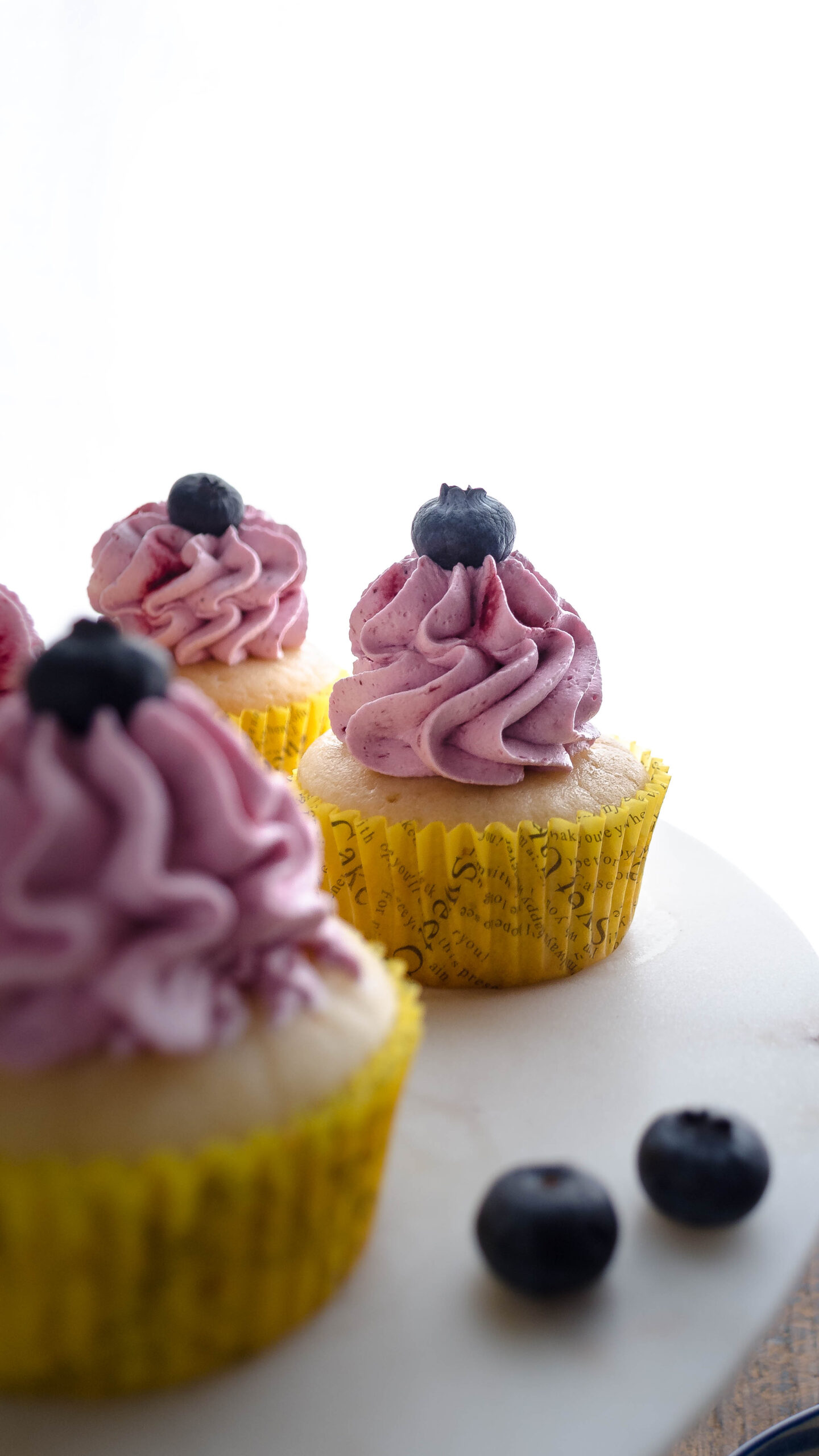Eggless Lemon Cupcakes with Blueberry Frosting, easy cupcake recipes, lemon cupcakes, eggless cupcakes