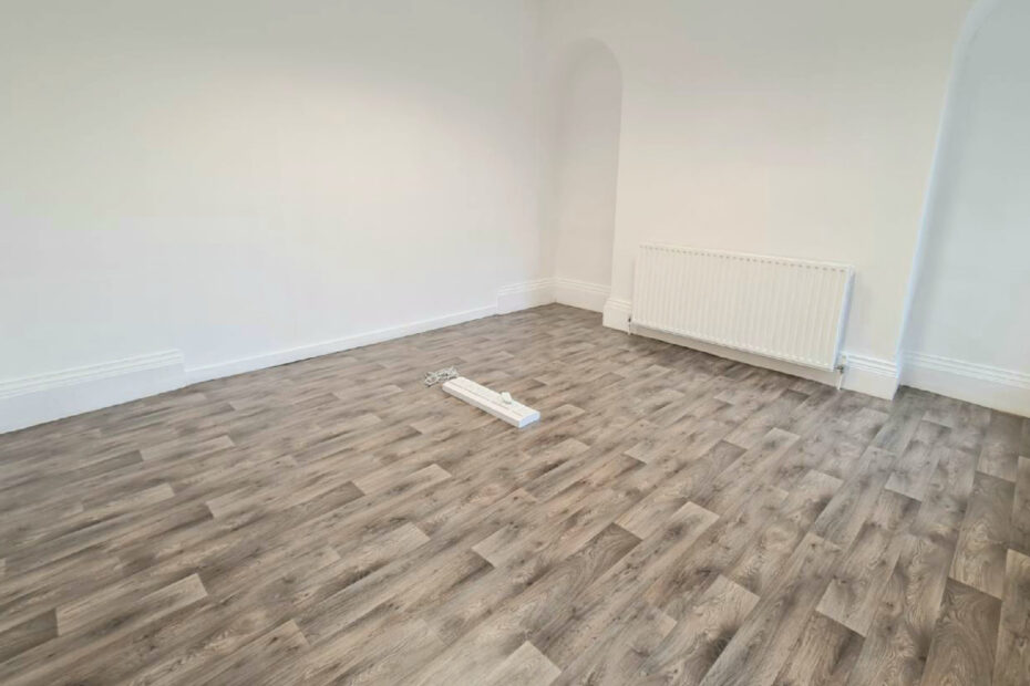 An empty studio space with white walls