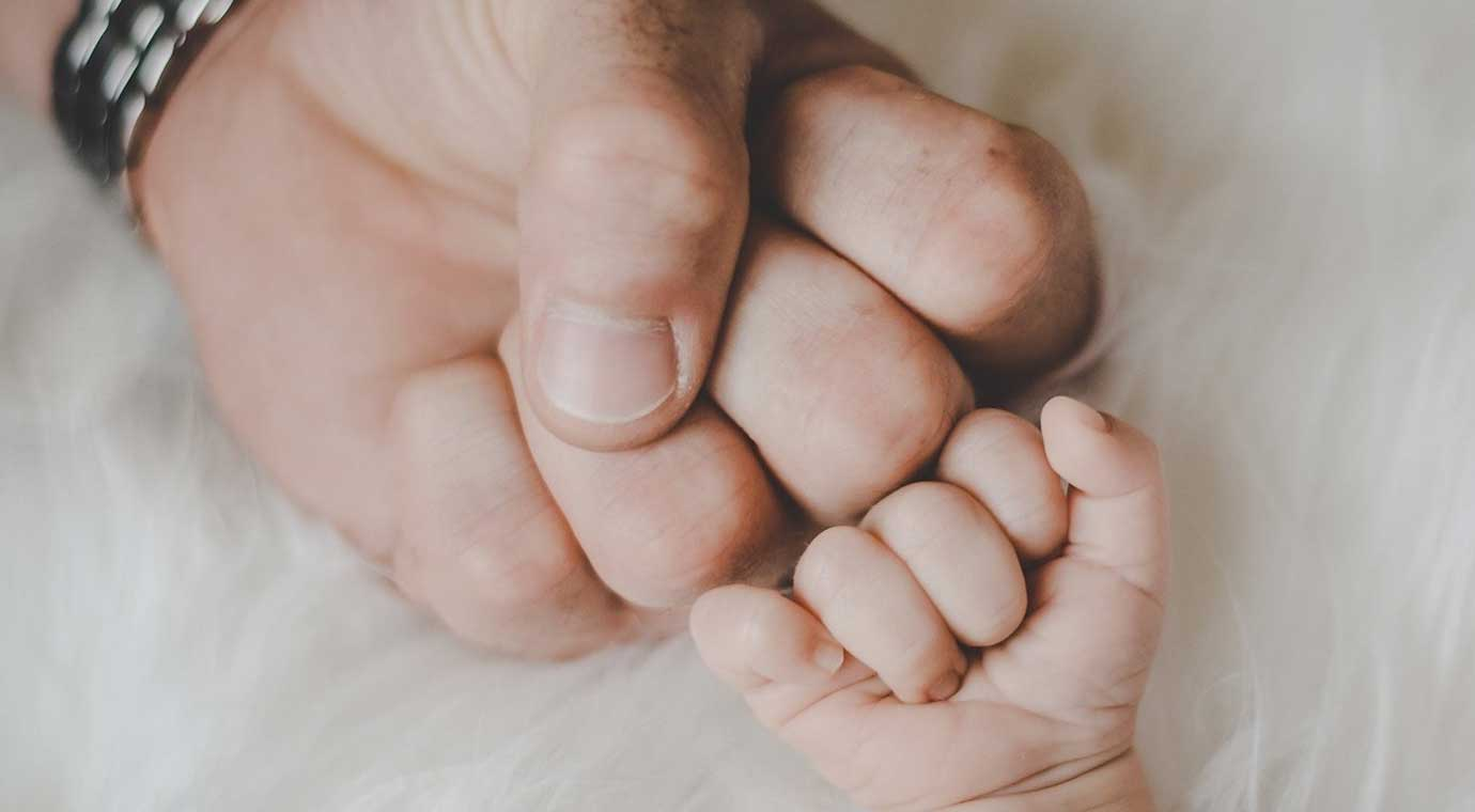 Dad and son fist bump