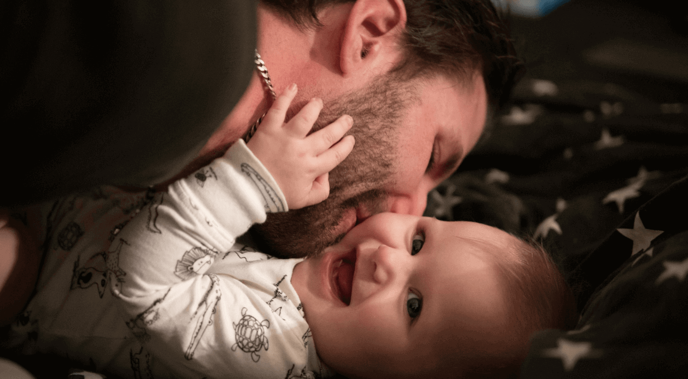 Dad playing with baby daughter