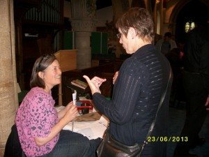 Jo Ward (seated), our Audience Development consultant, giving out her questionnaires at Ickleford Open Village
