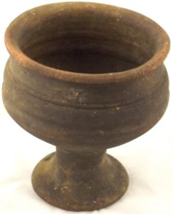 An earthenware pedestalled bowl