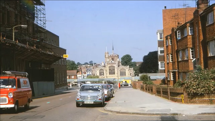 An urban street scene in 1973, looking towards a church in the distance