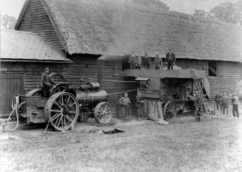 Threshing at Lilley using a traction engine and mechanical threshing machine. The thresher was made by Ransomes of Ipswich, a company which made 'thrashing' machines from 1841 until 1974.