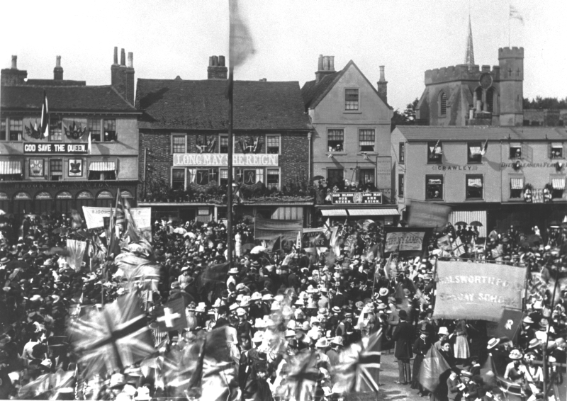 The crowds are celebrating Queen Victoria's Golden Jubilee on 20 June 1887. After years of unpopularity owing to her self-isolation after the death of Prince Albert, the Golden Jubilee helped to restore the Queen to public favour.
