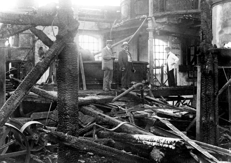 Investigating a burnt-out building, Royston, 1909