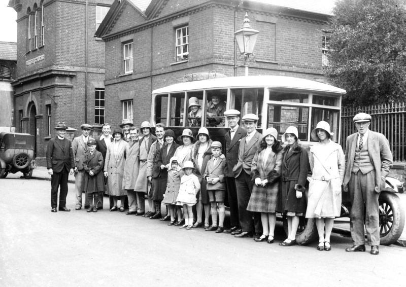 People assemble for a charabanc trip to Ashridge Park on 22 July 1930 outside the Congregational Chapel on Queen Street, Hitchin, 1930
