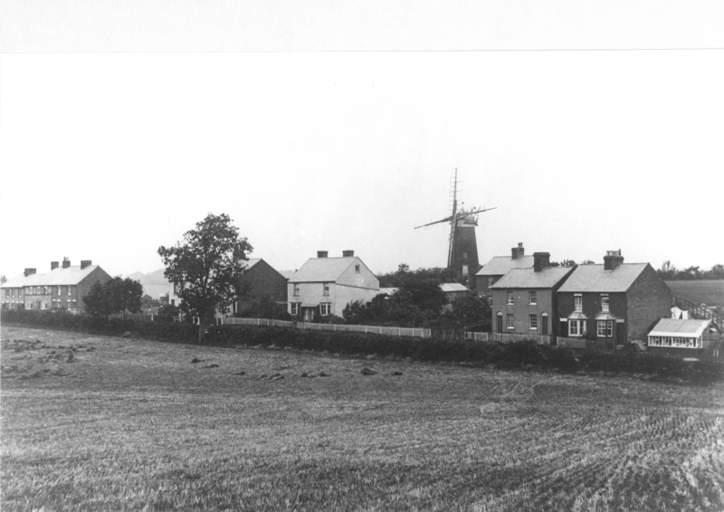 The windmill was actually in The Flints on Luton Road, half way between Great Offley and Lilley. It was built from red brick in 1855, last used as a windmill in 1895 and reduced to two storeys in 1926. The tower mill replaced an earlier wooden mill, first shown on a map of 1658. The Offley Bypass now runs behind the mill.